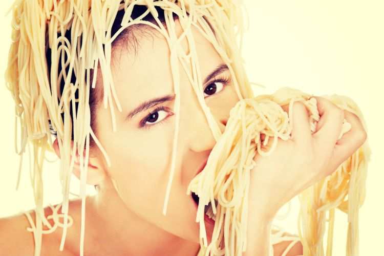 Sadly it's not likely you'll enjoy eating pasta as much as this woman if you're experiencing food intolerance symptoms