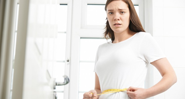 woman-unhappy-weight-loss-tape-measure