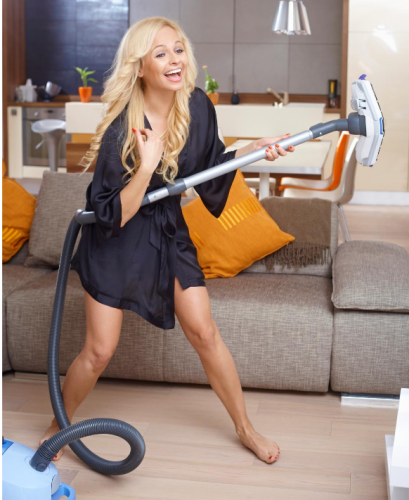 Woman dancing while cleaning