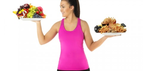woman-choosing-healthy-food-over-unhealthy-food