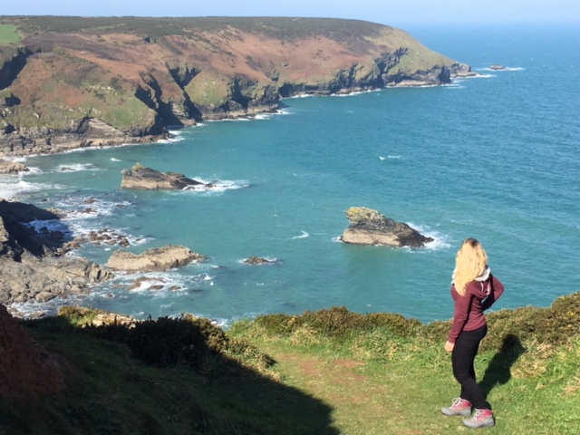 Me enjoying the view on a coastal path walk with my son.