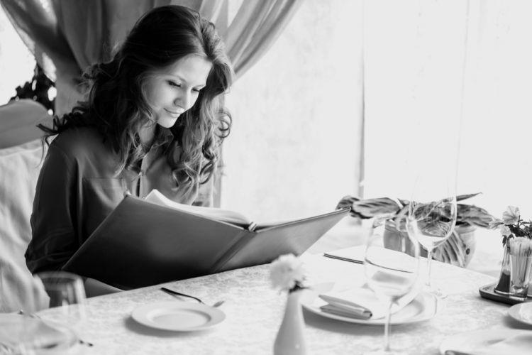 Woman choosing a meal from a menu