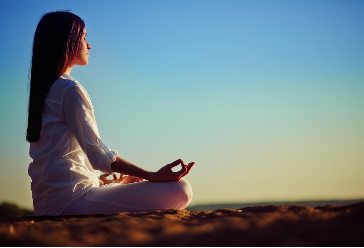 Woman meditating to reduce stress